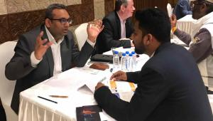 Abhishek Srivastava, Executive Director at Teknobuilt, in animated conversation sitting at a table across from a potential partner at a B2B event.