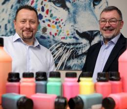 Multichem managing director Michael Nelson and EEN adviser David Boath with bottles of coloured inks in the foreground.