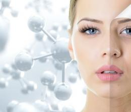 Computer-generated image of young woman with a backdrop of molecular structures