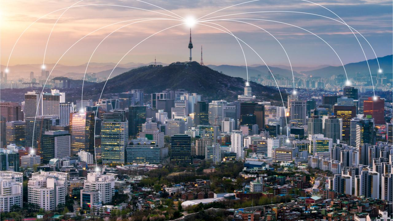 Seoul downtown city skyline with network connection concept, Aerial view of N Seoul Tower at Namsan Park in twilight sky in morning.