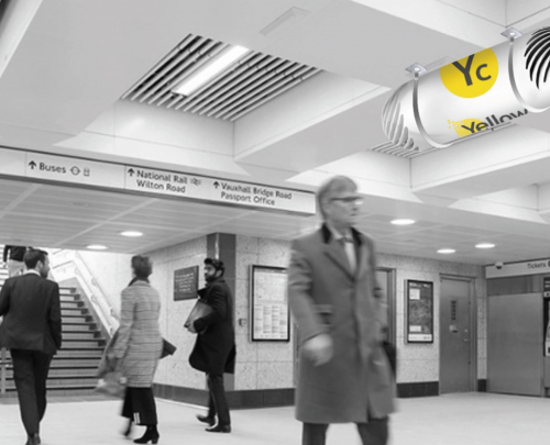 Computer generated image of Yellow Collective fan installed in railway station underground walkway, above commuters